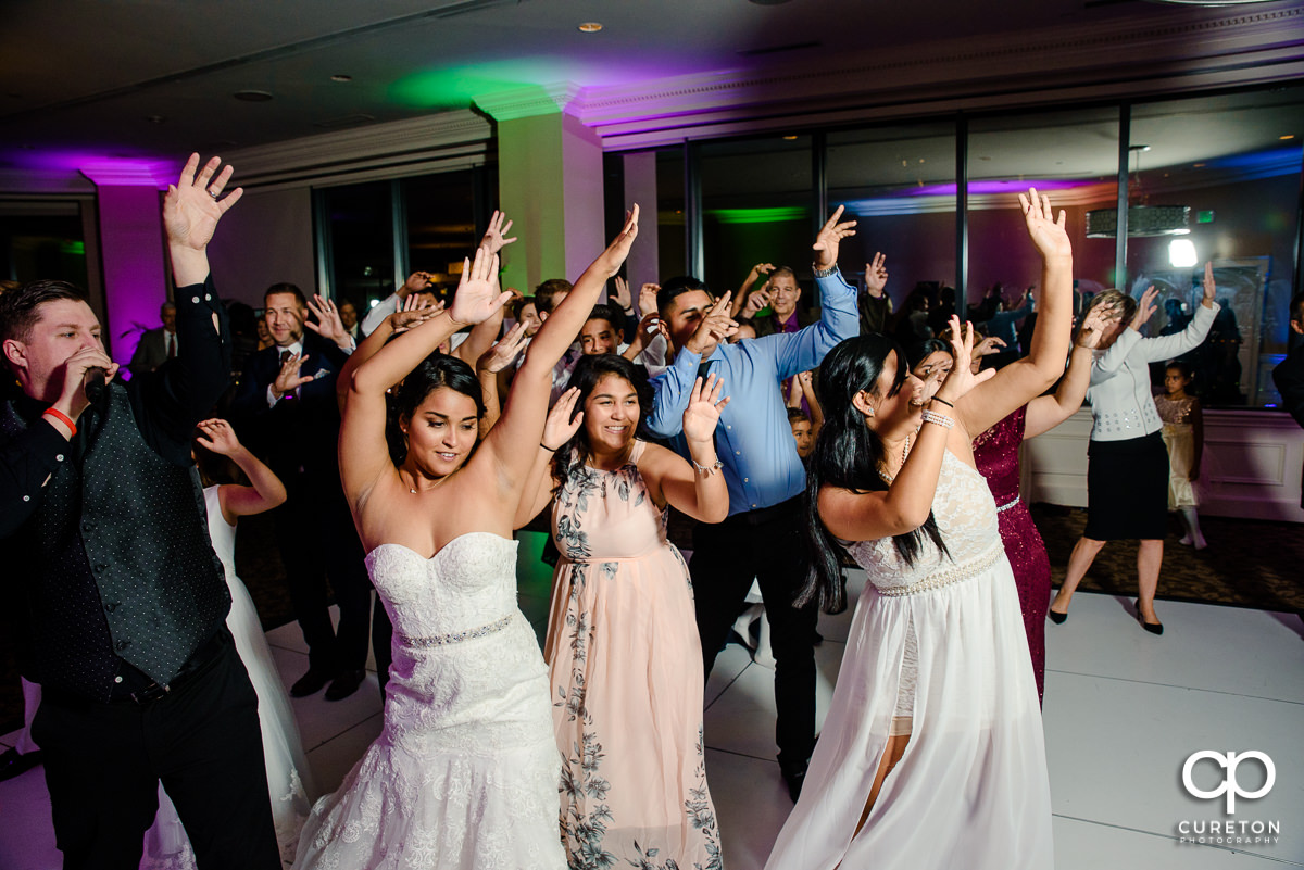 Shawn with Jumping Jukebox showing the packed reception dance floor some moves.