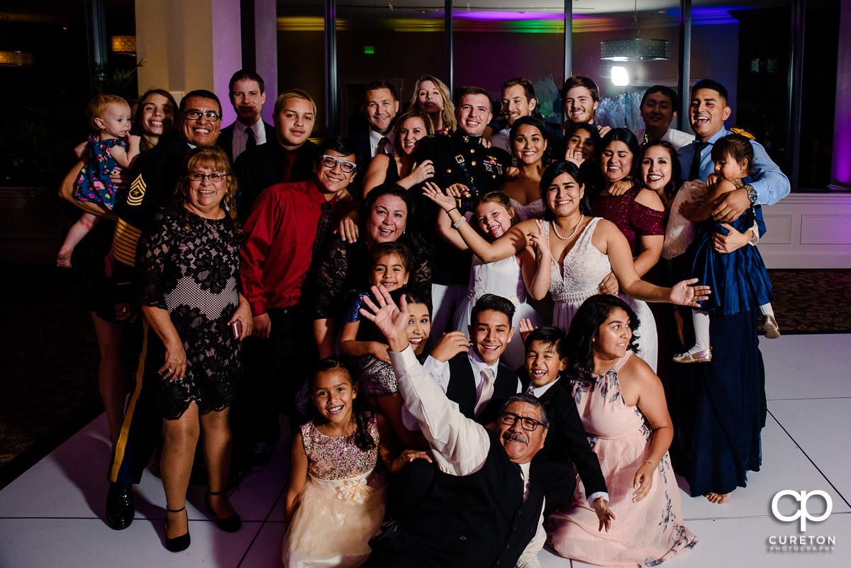 Wedding guests posing on the dance floor.