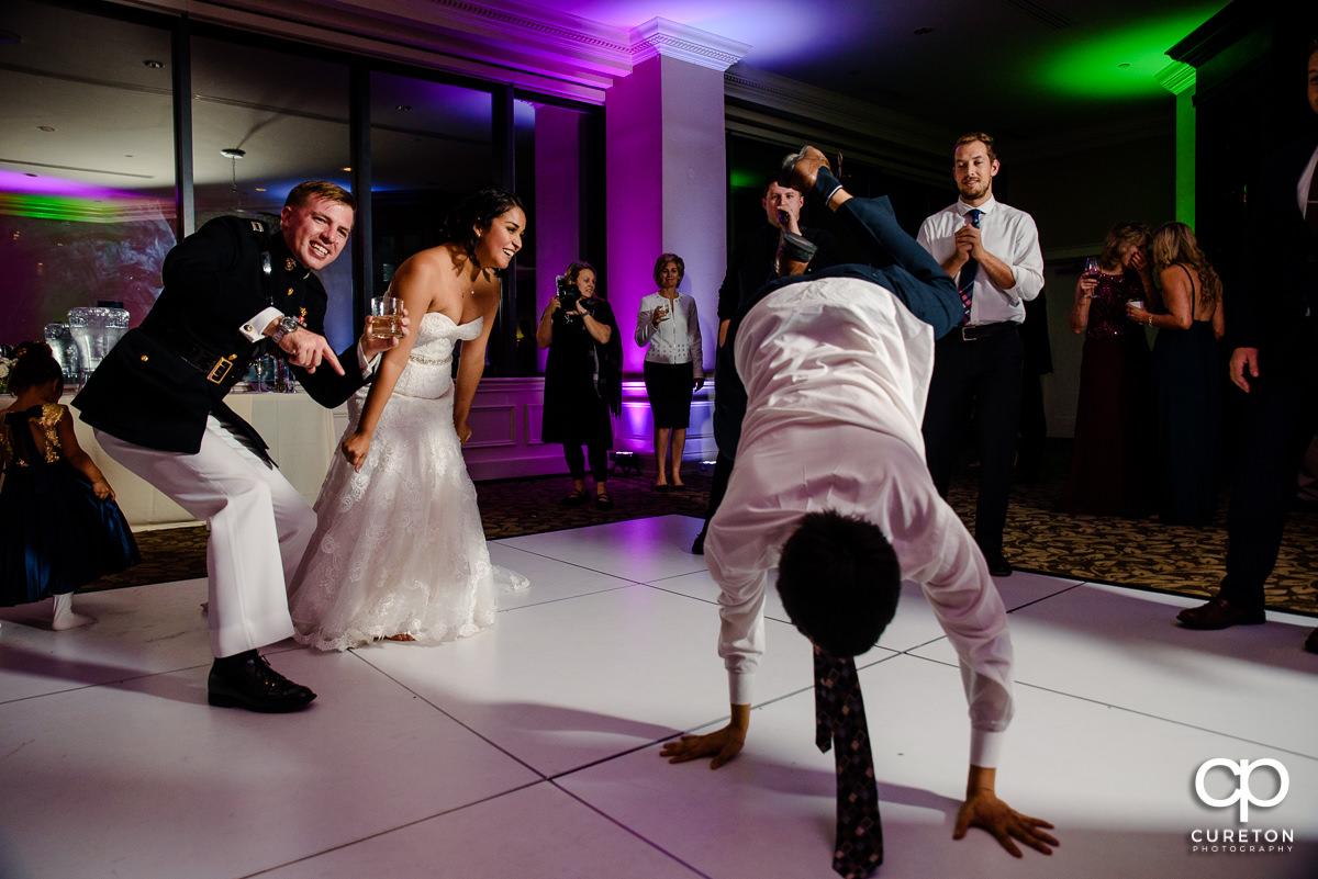 Wedding guests break dancing.