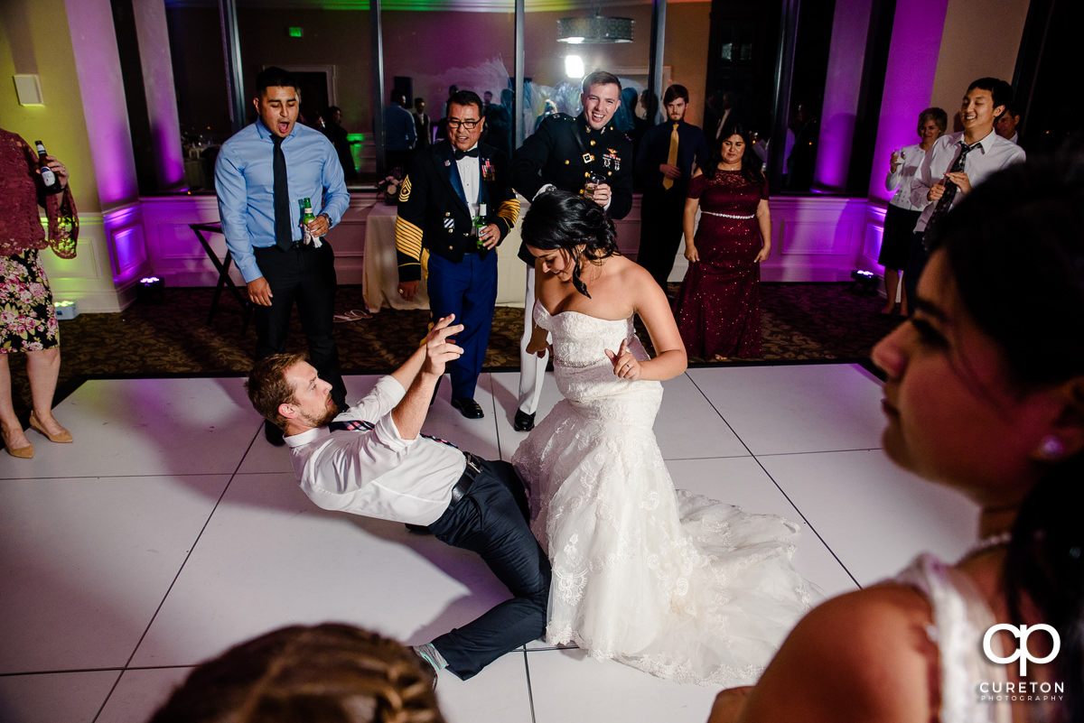Bride dancing with a wedding guest.