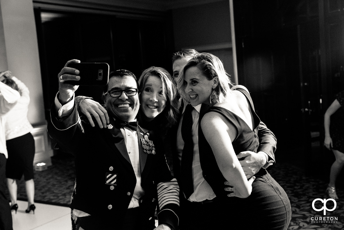 Reception guests taking a selfie.