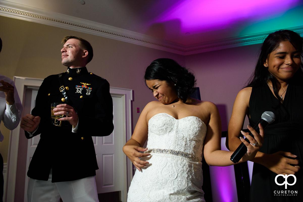 Bride air guitaring.