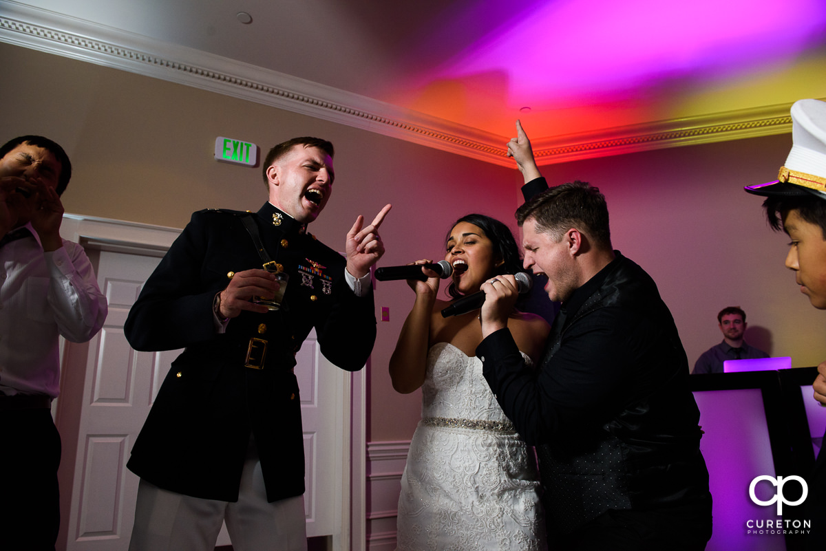 Bride and groom singing with Jumping Jukebox at their Commerce Club wedding reception.