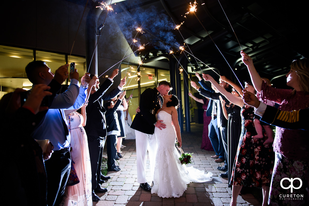 Bride and groom making a grand sparkler exit at the Commerce Club.