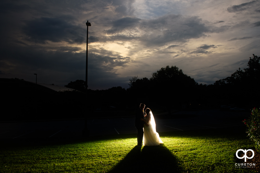 Bride and groom silhouette at sunset after their Loom wedding.