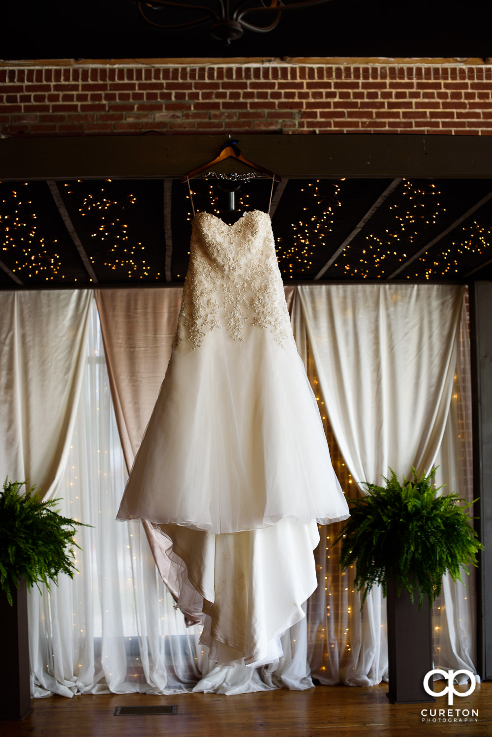Bride's dress hanging on the alter.