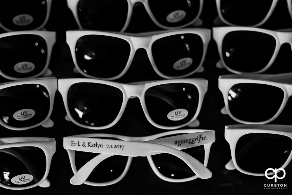 Custom bridal favors that were imprinted sunglasses.
