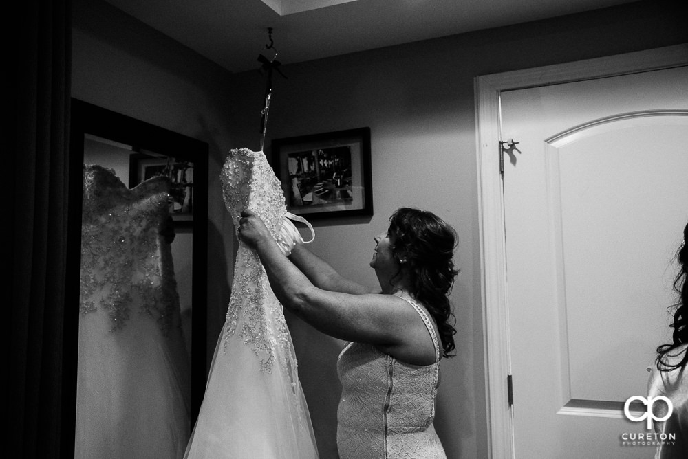 Bride's mom looking at her dress.
