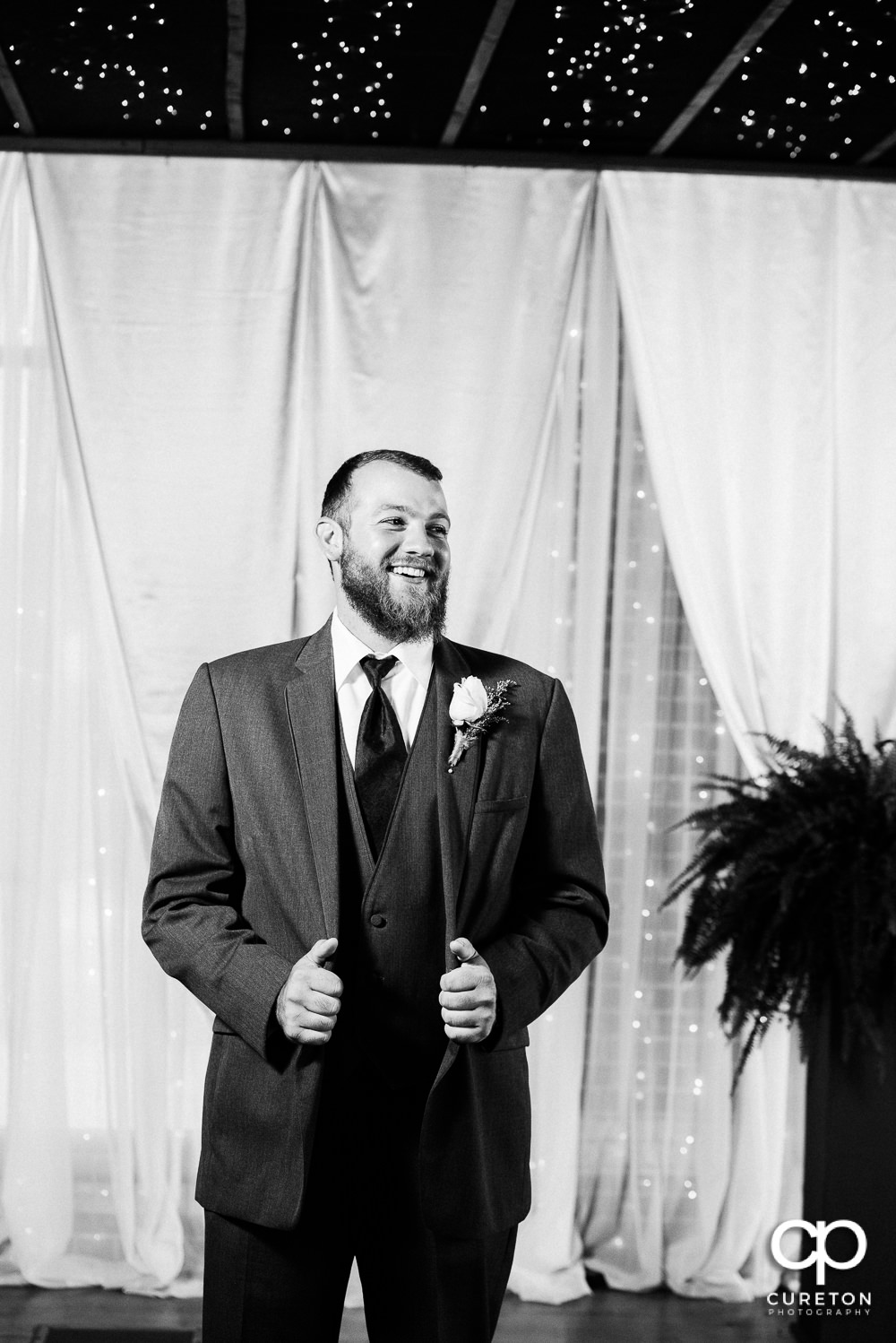 Groom standing at the alter.