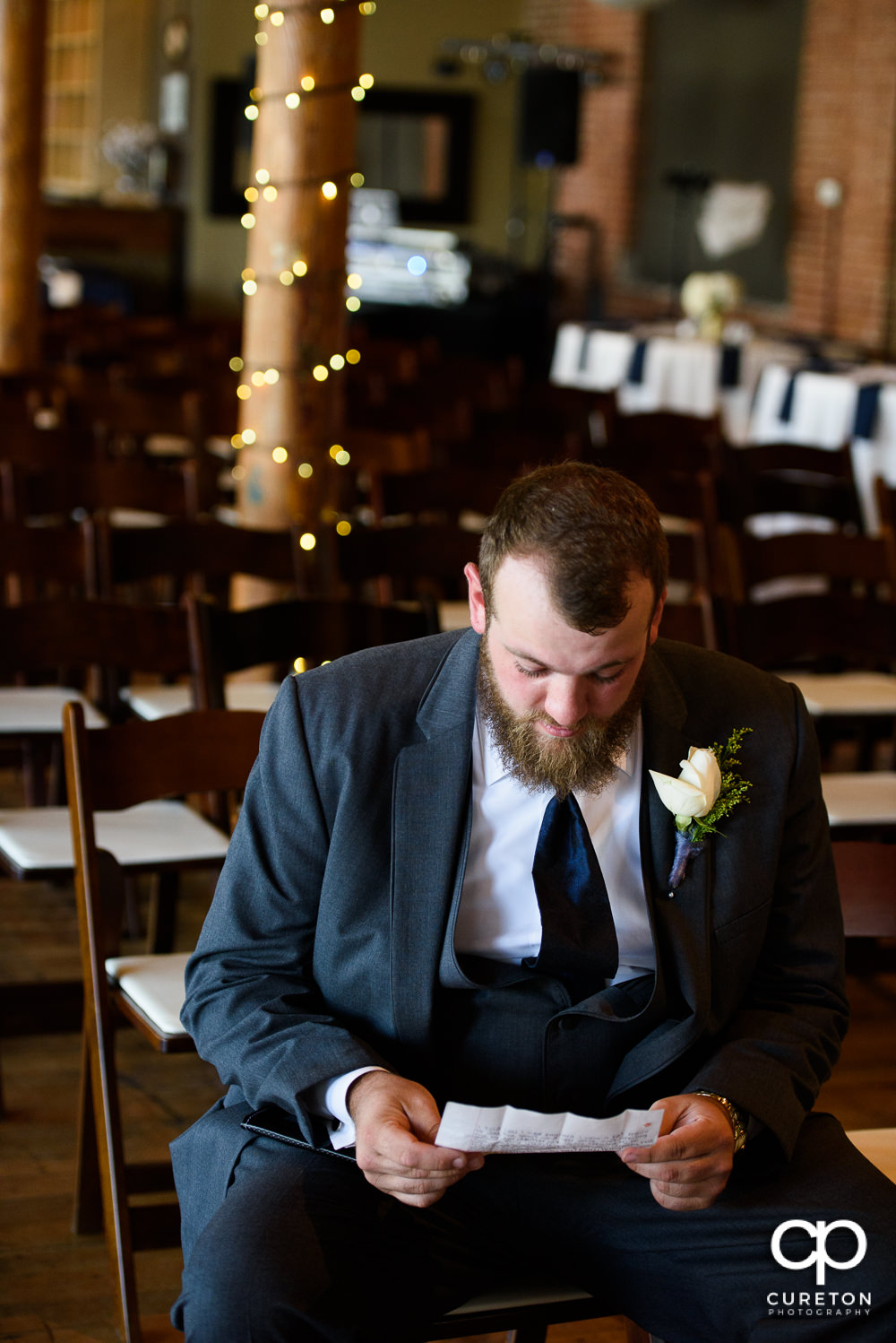 Groom reading a pre-wedding note from his bride.