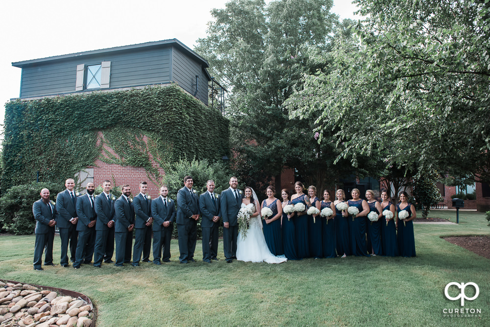 The entire wedding party out back of the Loom at Cotton Mill Place.