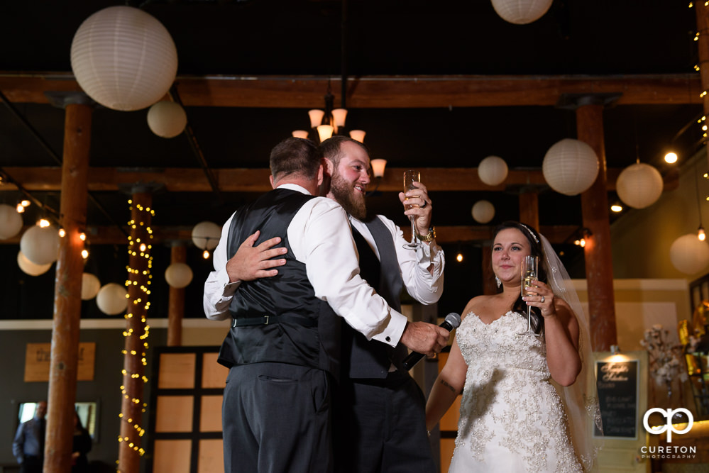 The best man and maid of honor giving toasts at the reception.