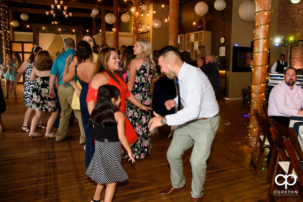 Wedding guests dance at the reception to the sounds of DJ EZ.