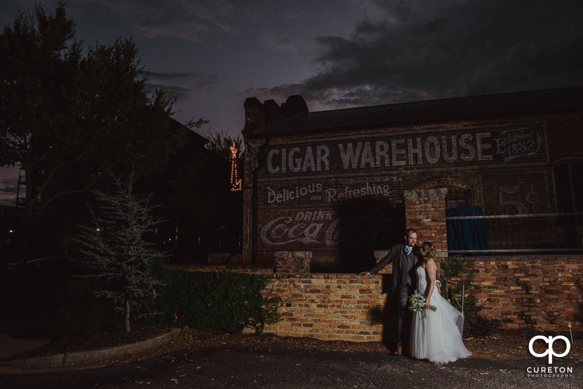 Bride and groom outside their wedding reception at The Old Cigar Warehouse.