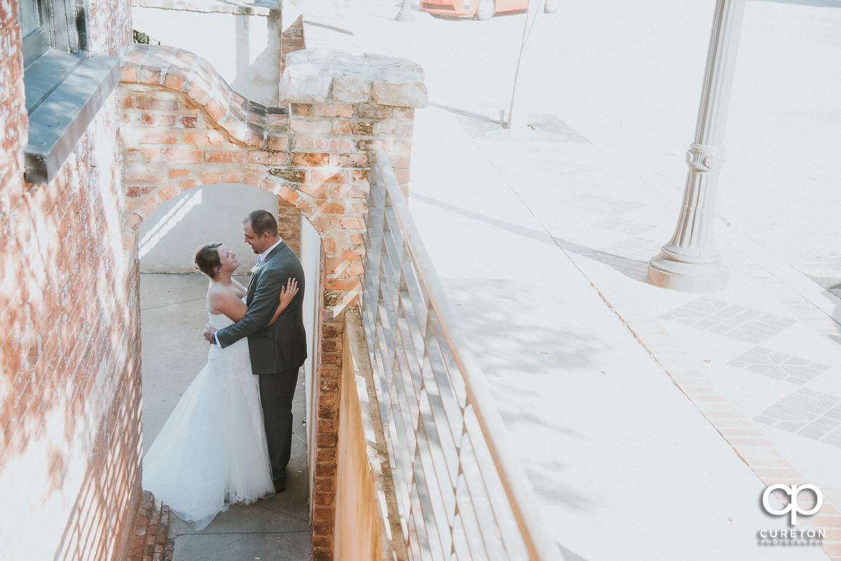 Bride and groom downstairs outside at The Old Cigar Warehouse.