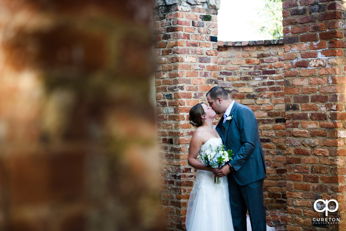 Groom kissing his bride before their Old Cigar Warehouse wedding.