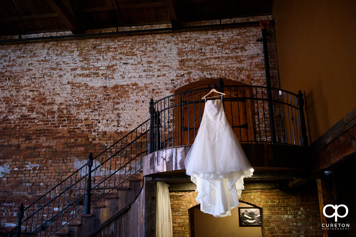 Bridal dress on the staircase at Old Cigar Warehouse.