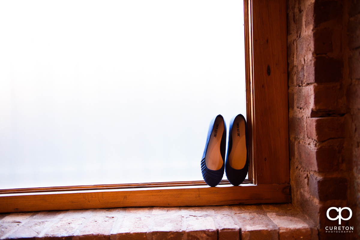 Wedding shoes in a window at Old Cigar Warehouse.