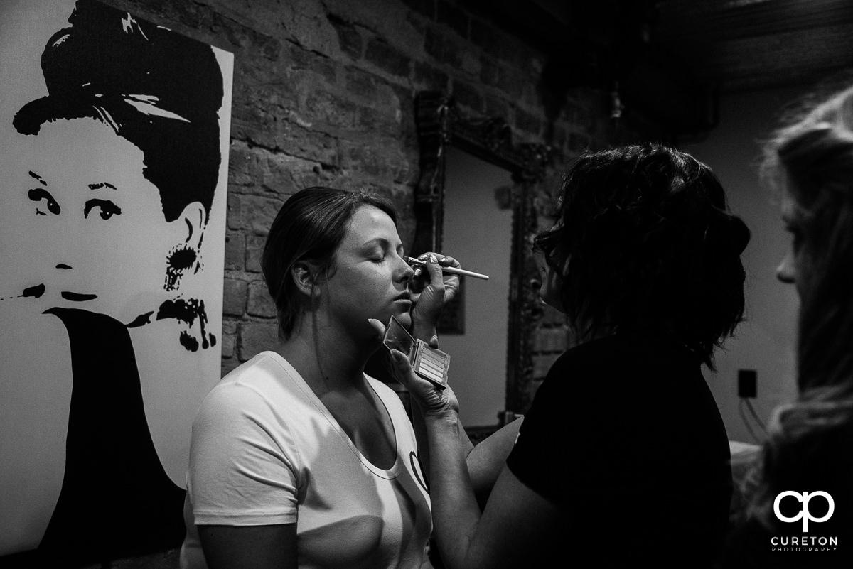 Bride getting eye makeup applied.