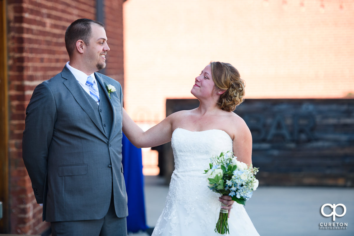 Bride and groom first look on the deck at Old Cigar Warehouse.
