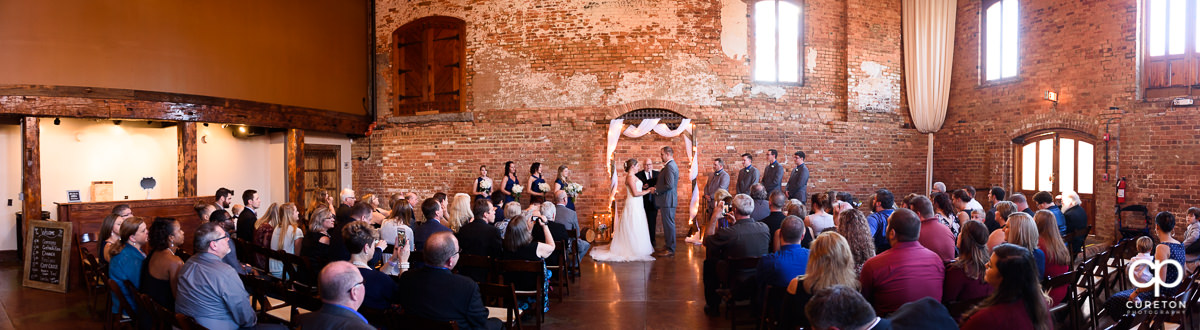 Panoramic view of a wedding ceremony at The Old Cigar Warehouse in downtown Greenville,SC.