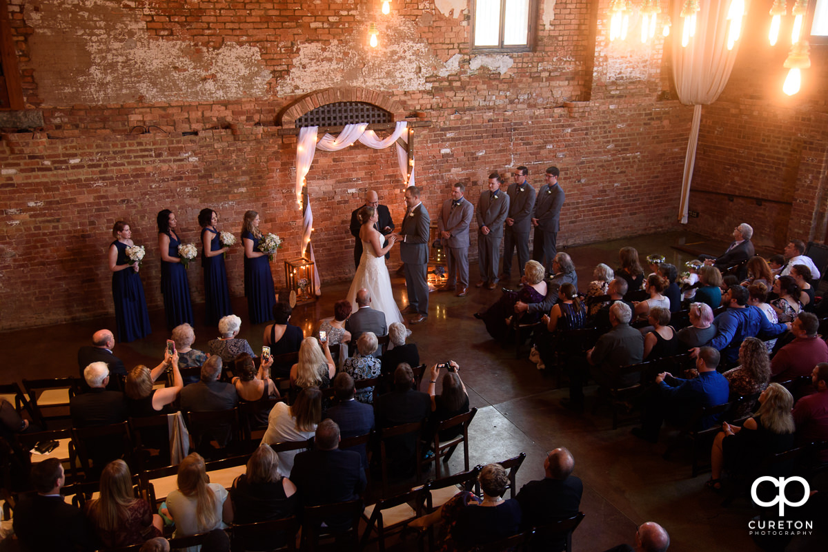 Wedding ceremony in the main hall at The Old Cigar Warehouse.