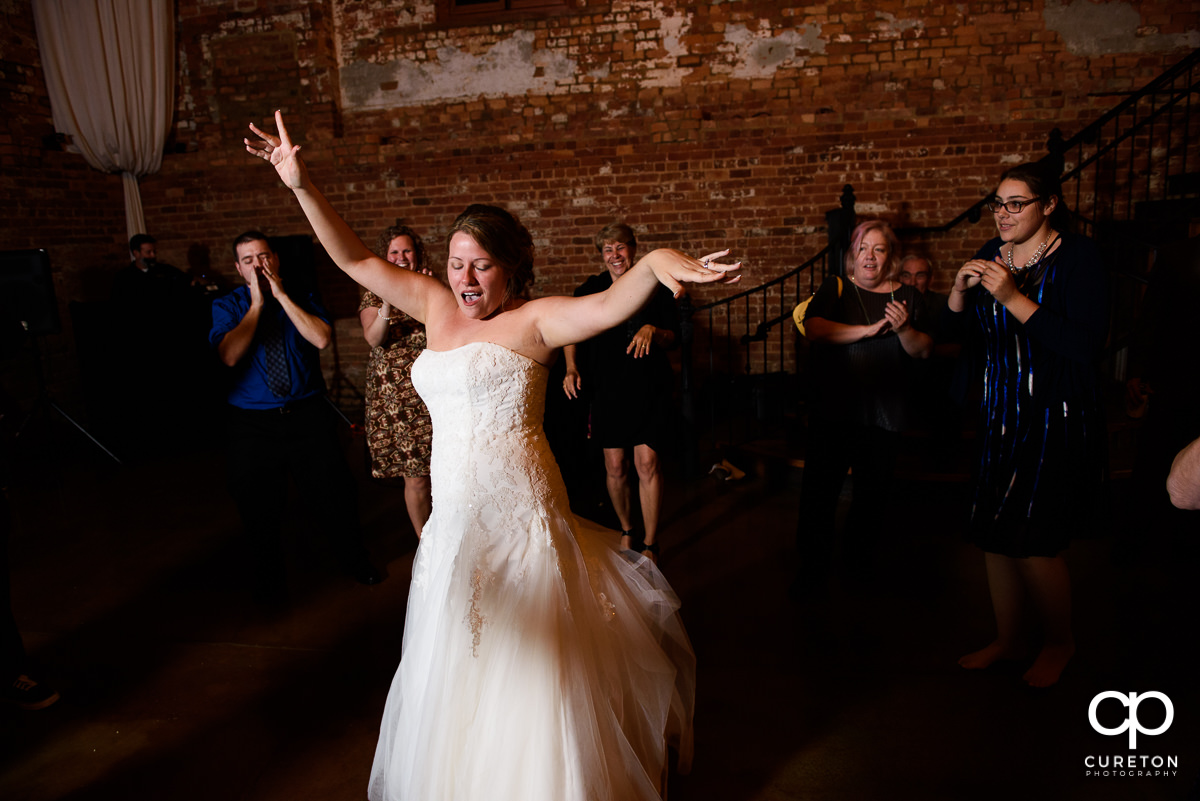 Bride dancing during her reception at The Old Cigar Warehouse.