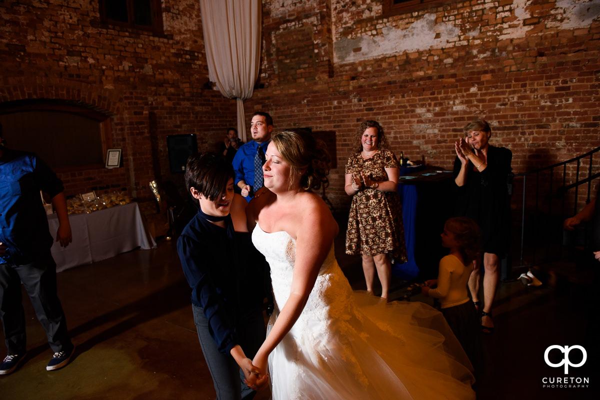 Bride dancing with her niece.
