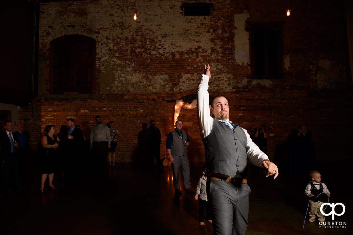Groom tossing the garter.