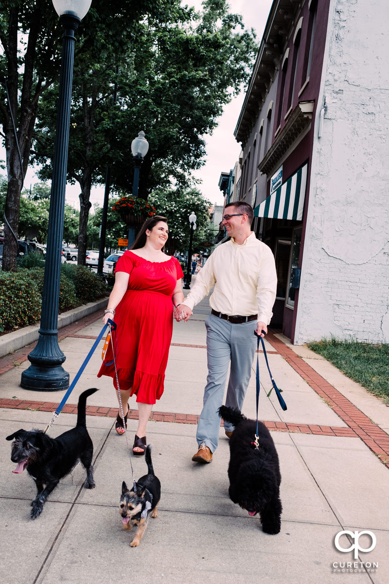 Engaged couple walking their dogs in downtown Greenville,SC.