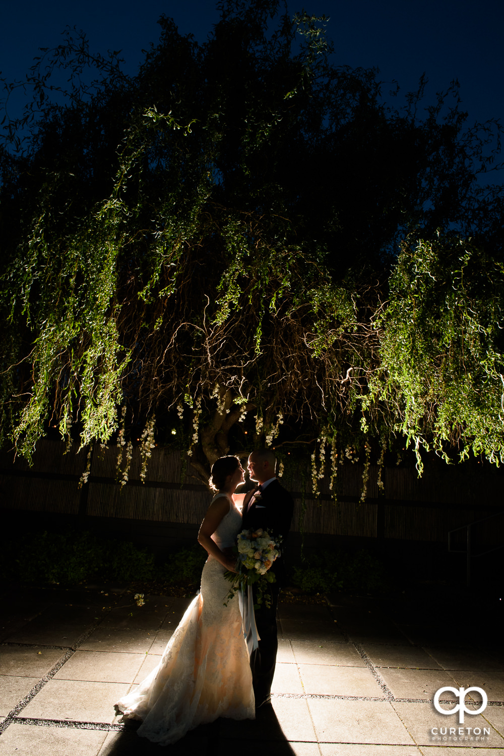 Bride and Groom outside at sunset during their wedding reception at Zen Greenville.