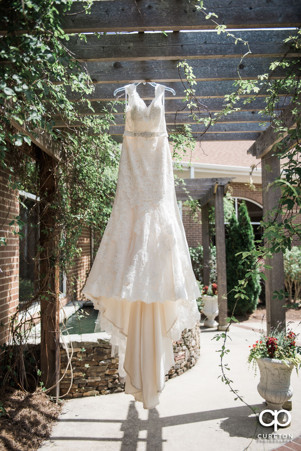 Bride's dress hanging at the church.