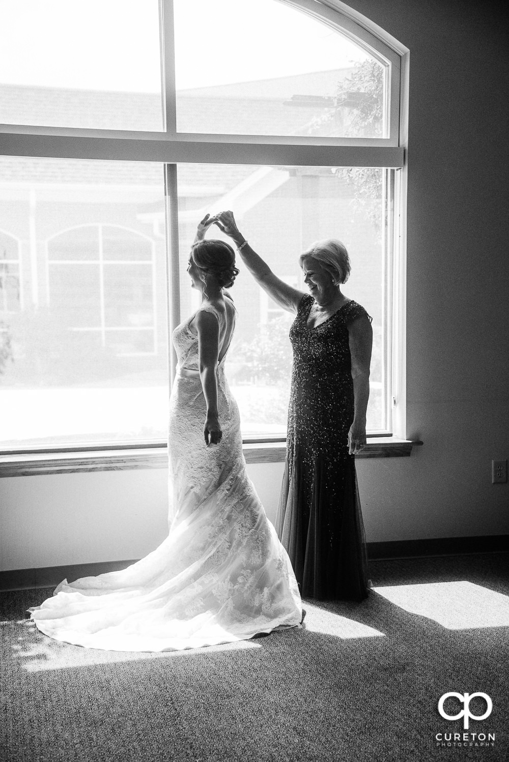 Bride and her mother sharing a moment before the ceremony at Covenant United Methodist Church.