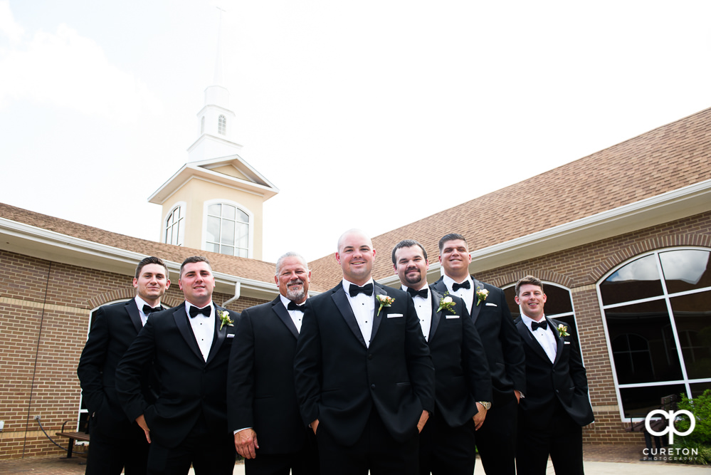 Groom and groomsmen in the courtyard before the wedding ceremony.