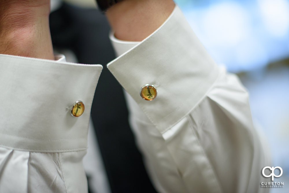 The groom's Harry Potter cufflinks.