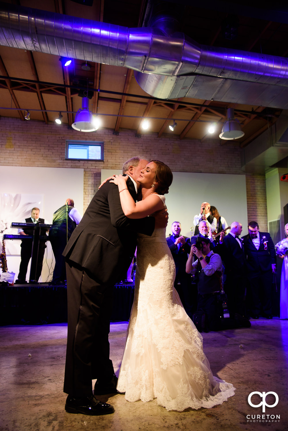 Bride and father dance at the wedding reception at Zen in downtown Greenville SC.