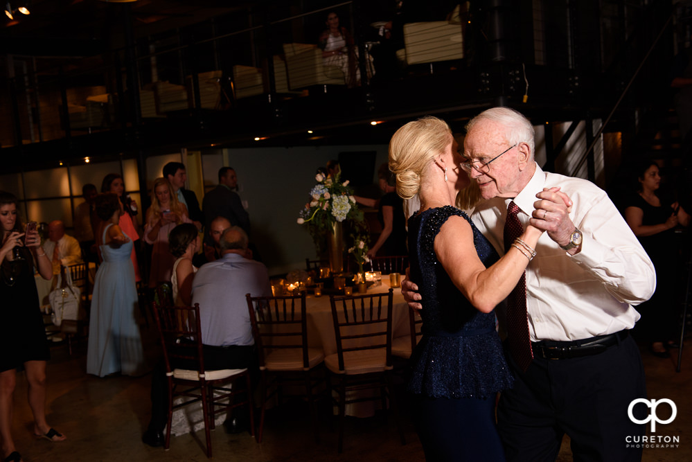 Groom's mother and grandfather dancing.