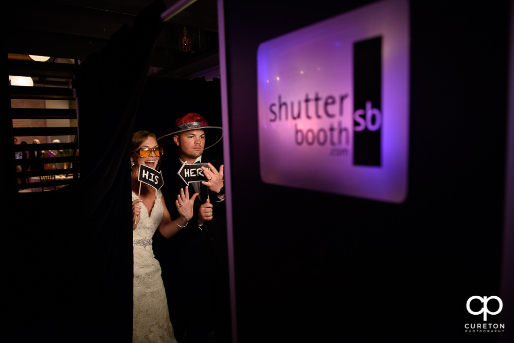 Bride and groom in the Shutter Booth photo booth.