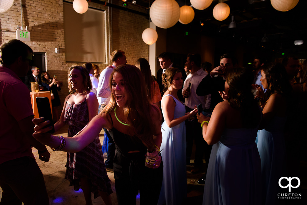 The wedding guests dancing at the reception at Zen.