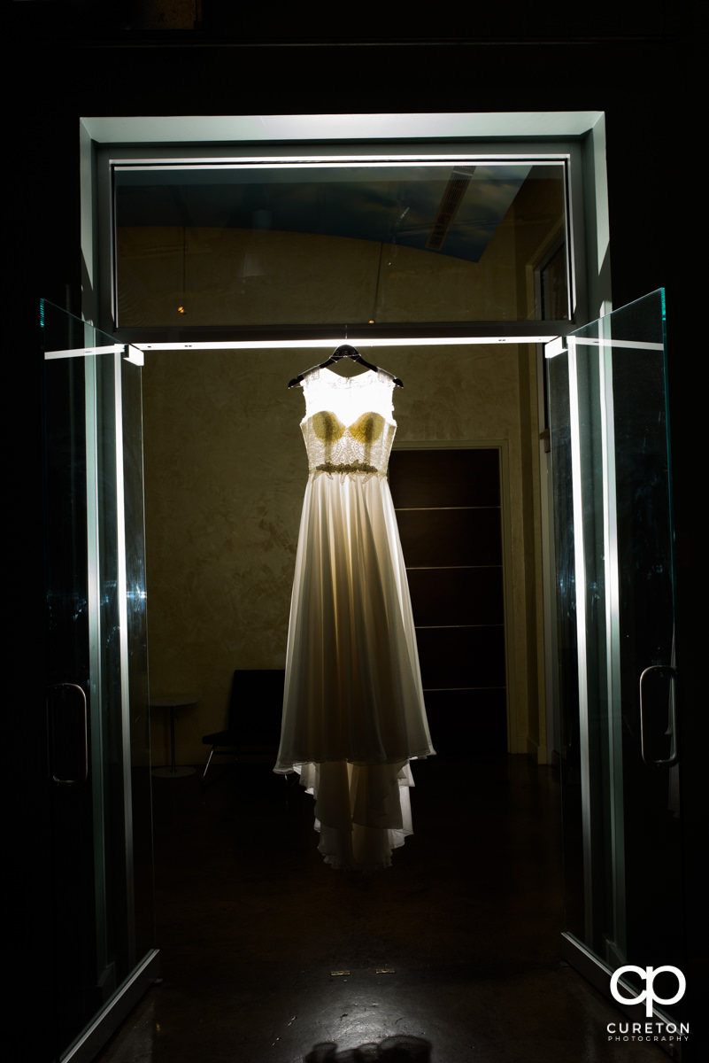 Bride's dress hanging in Zen.
