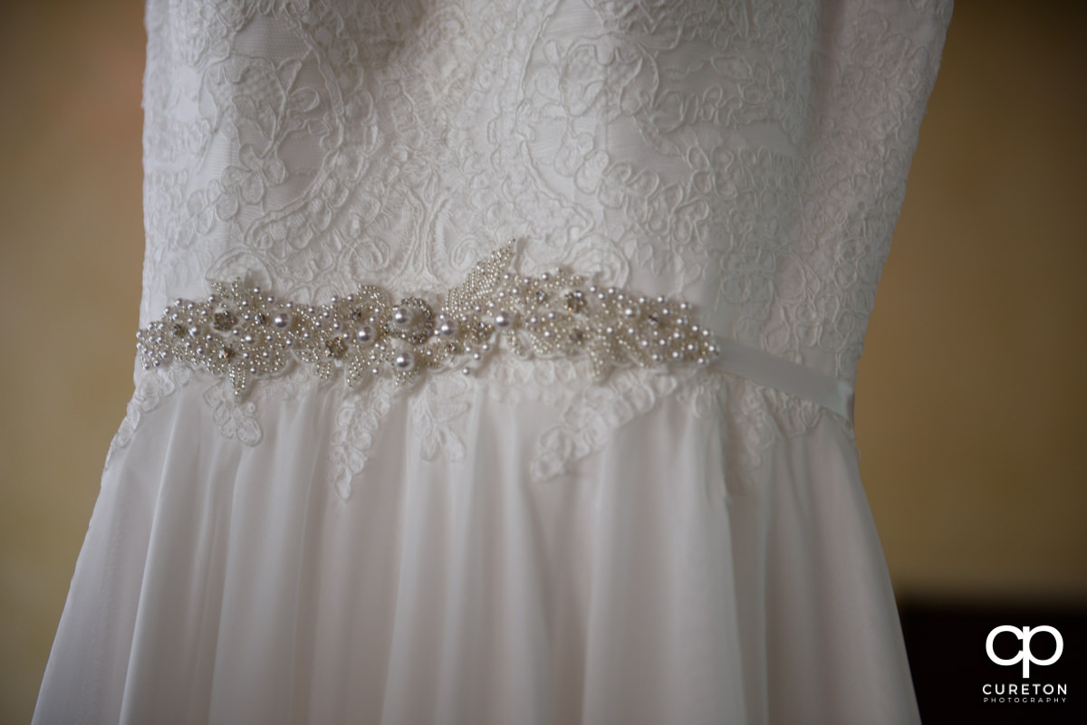 Detail on the bride's dress.