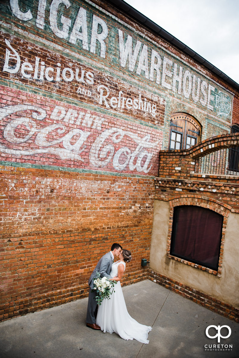 Bride and groom dancing before their wedding ceremony at The Old Cigar Warehouse.