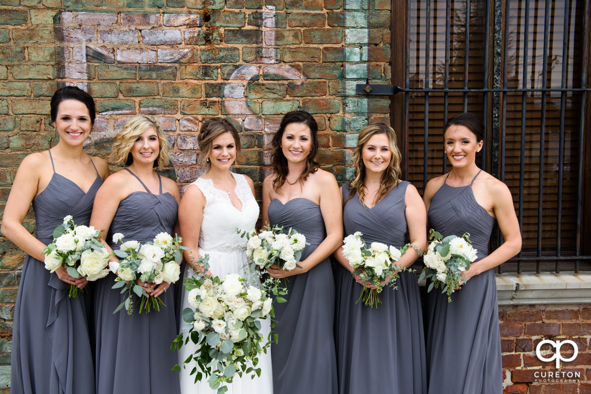 Bridesmaids on the deck of the Old Cigar Warehouse.