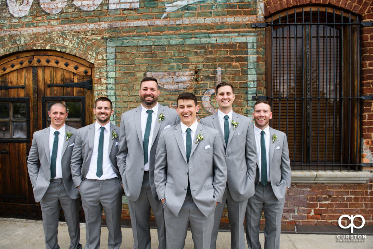 Groomsmen hanging out before the ceremony at The Old Cigar Warehouse.
