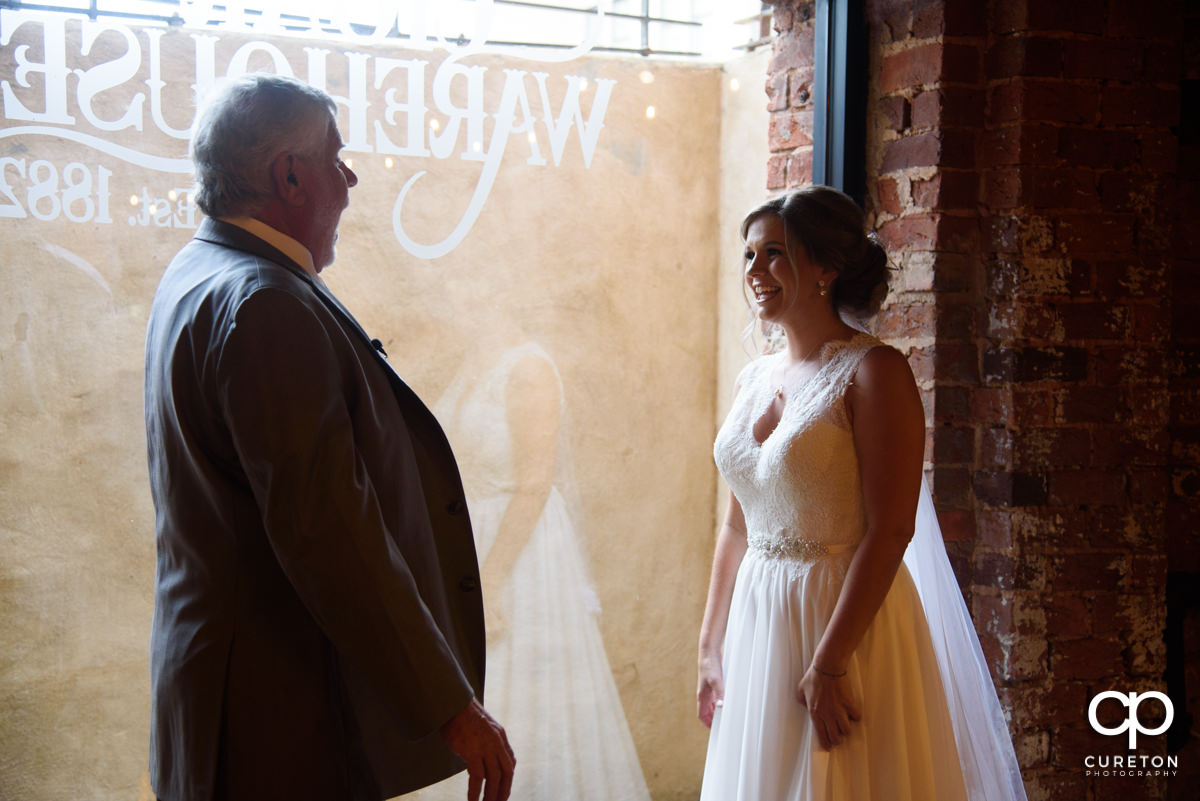 Bride sharing a first look with her father.