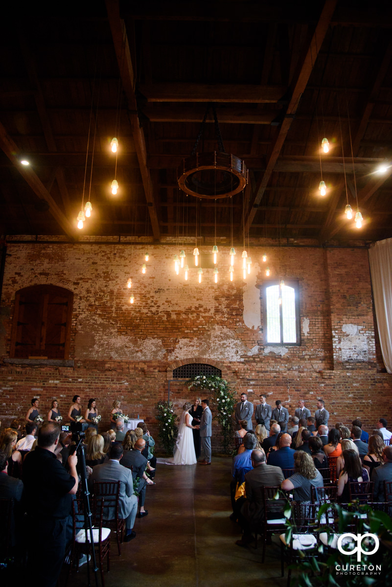 Wedding ceremony at The Old Cigar Warehouse in downtown Greenville,SC.