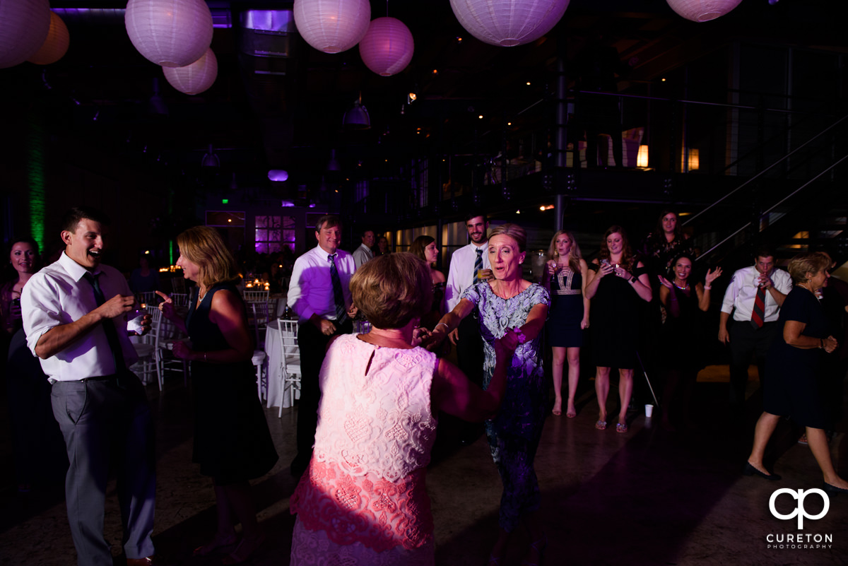 Guests dancing at the wedding reception at Zen in Greenville ,SC.