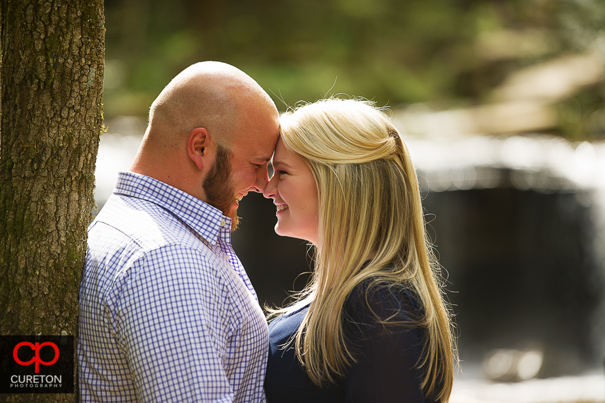 A couple looks into each other eyes during their Pearson's Falls engagement session.