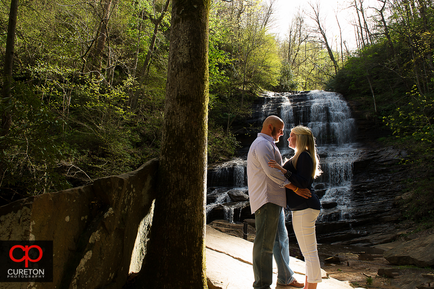 An engaged couple in the spot that he proposed during their Pearson's Falls engagement session.