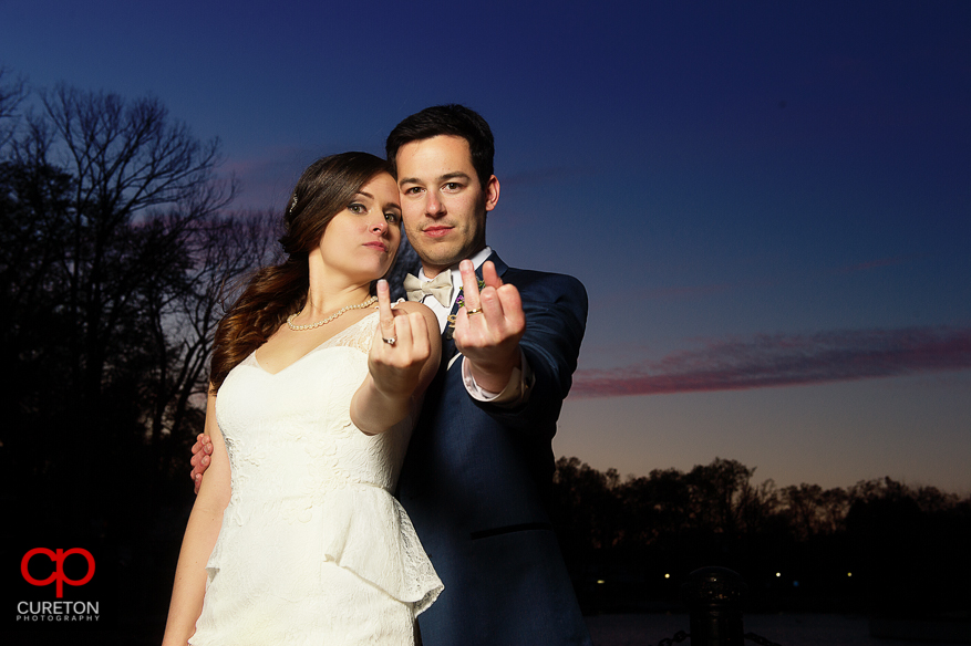 Bride and groom showing off their rings Johnny Cash style.